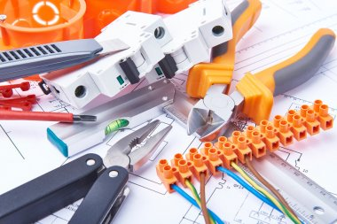 Components for use in electrical installations. Cut pliers, connectors, fuses, knife and wires. Accessories for engineering work, energy concept.