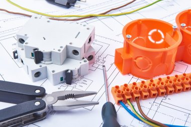 Components for use in electrical installations. Cut pliers, connectors, fuses and wires. Accessories for engineering work, energy concept.