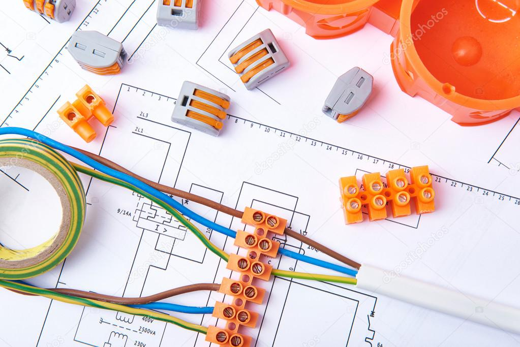 electrical connectors with wires junction box and different materials used  for jobs in electricity many tools lying on diagrams 98992362