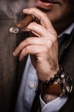 elegant man smokoing cigar