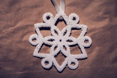 Christmas decoration, white snowflake from styrofoam  on paper, shot from above stock vector
