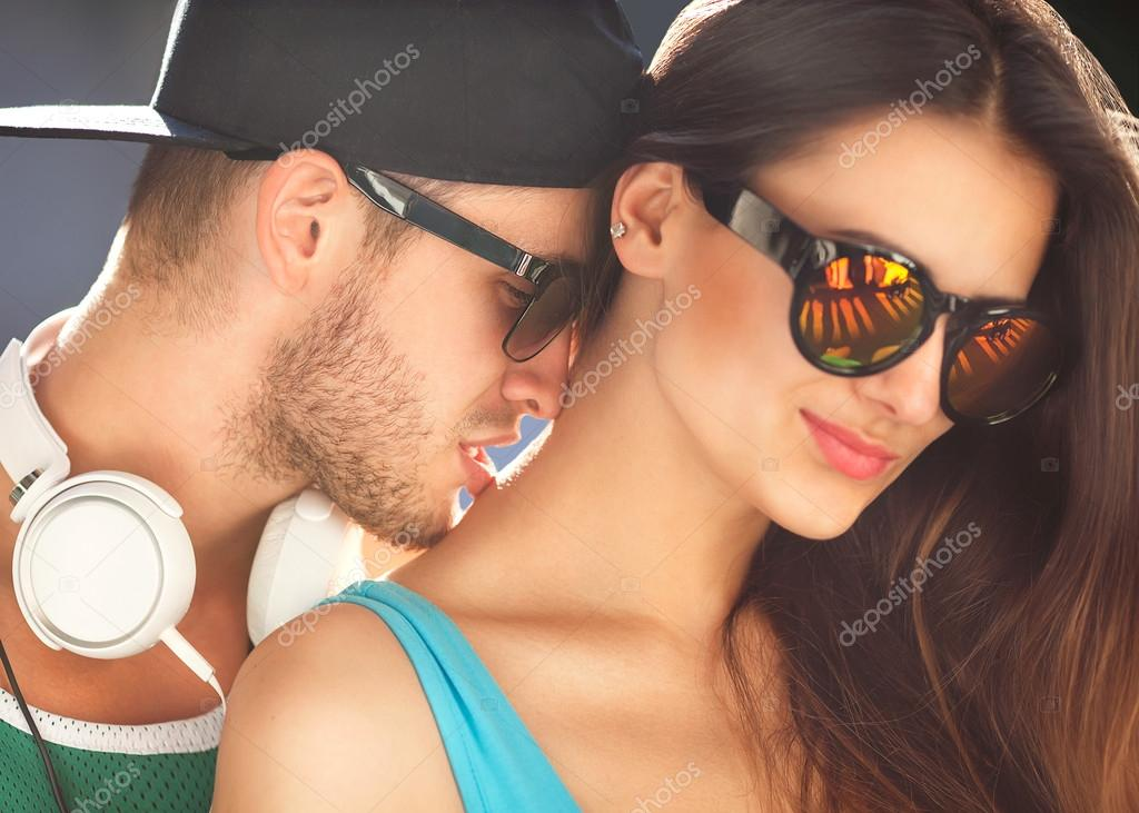 Close up portrait of happy smiling couple in love. Wearing retro