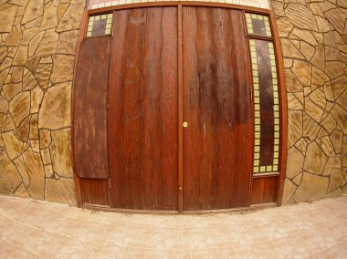 Wooden door in a stone wall