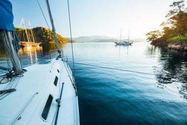 Sailing boats anchored in calm bay