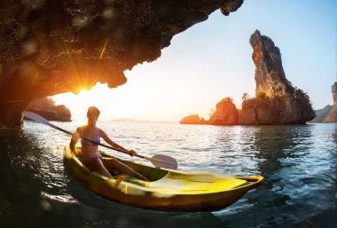 Lady paddling kayak
