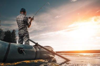Mature man fishing on the lake