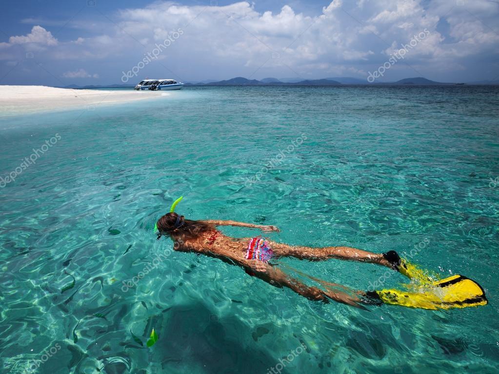 Lady snorkeling in sea