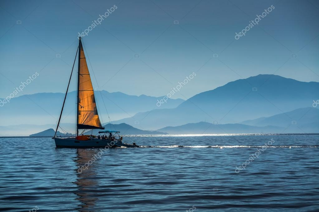 Sailing boat in a calm bay