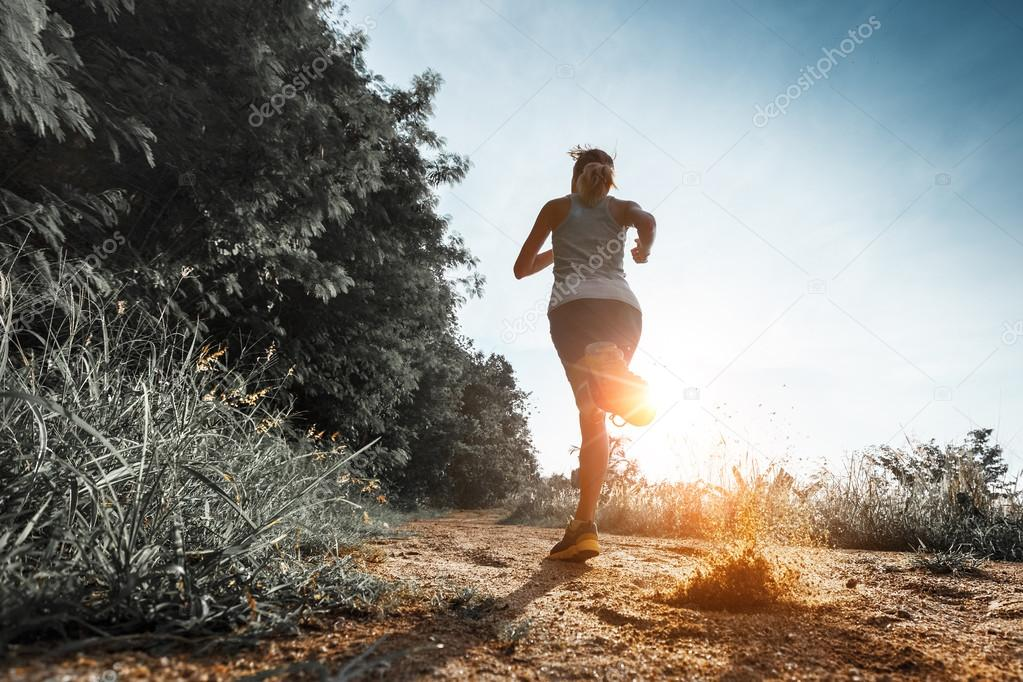 Woman running on the road