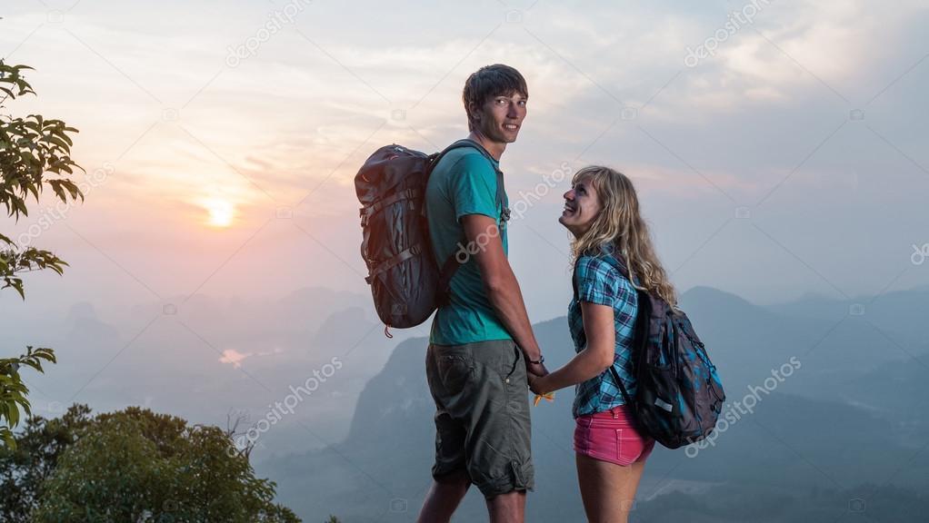 Couple of hikers enjoying sunrise