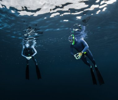 Two free divers preparing for the dive