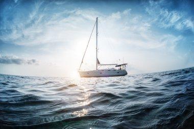 Sailing boat anchored in open sea
