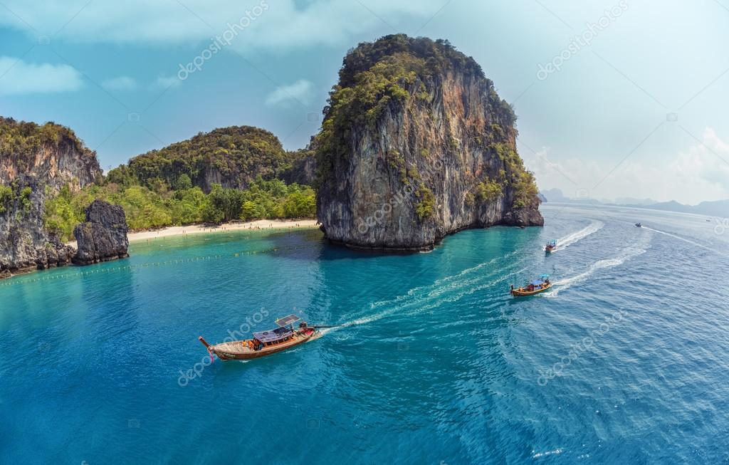 sea with traditional longtail thai boats