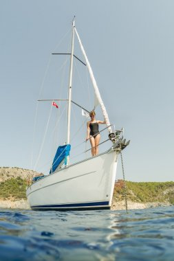 Youlg lady standing on the sail boat