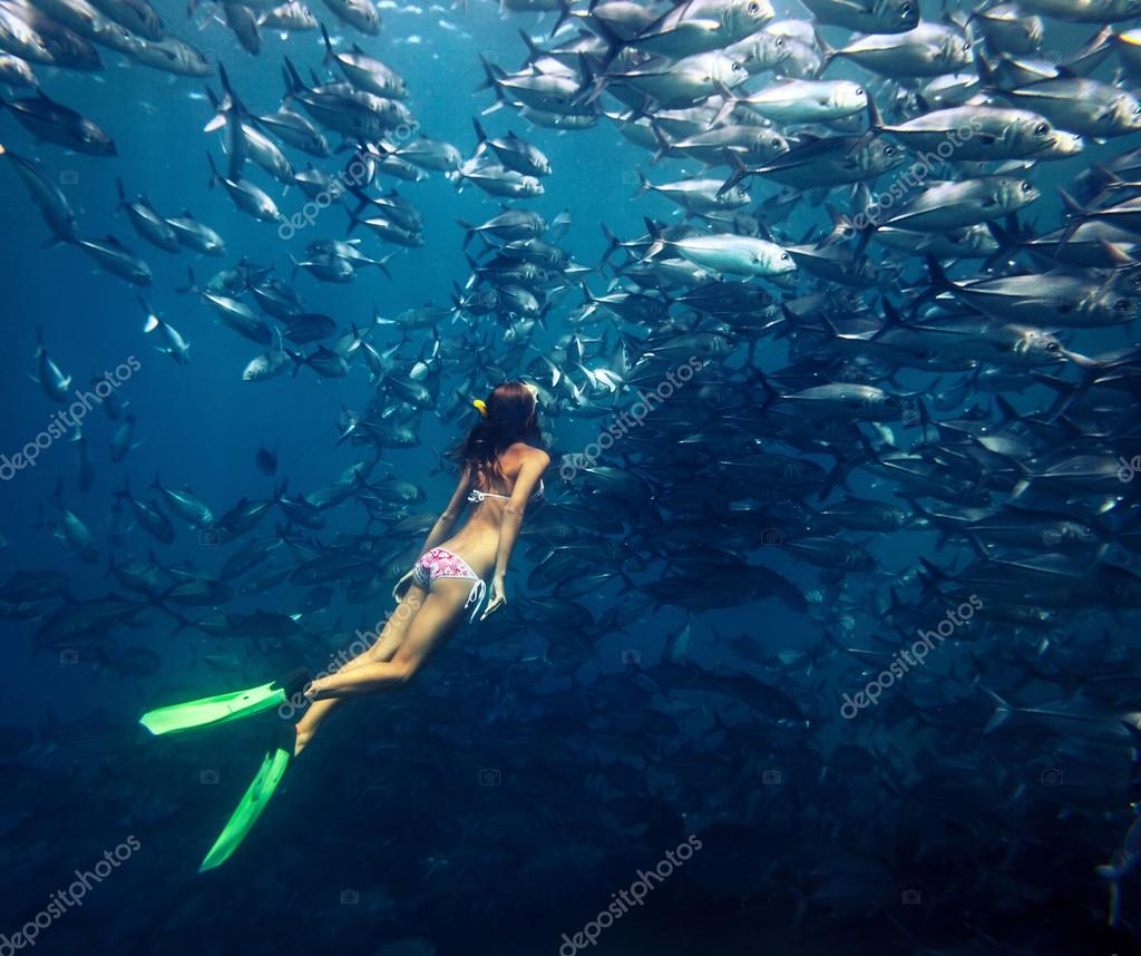 Freediver and fish