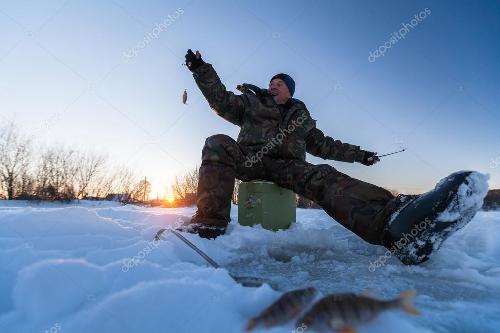 Fisherman on the winter lake