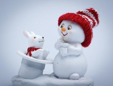 Cheerful snowman shows tricks
