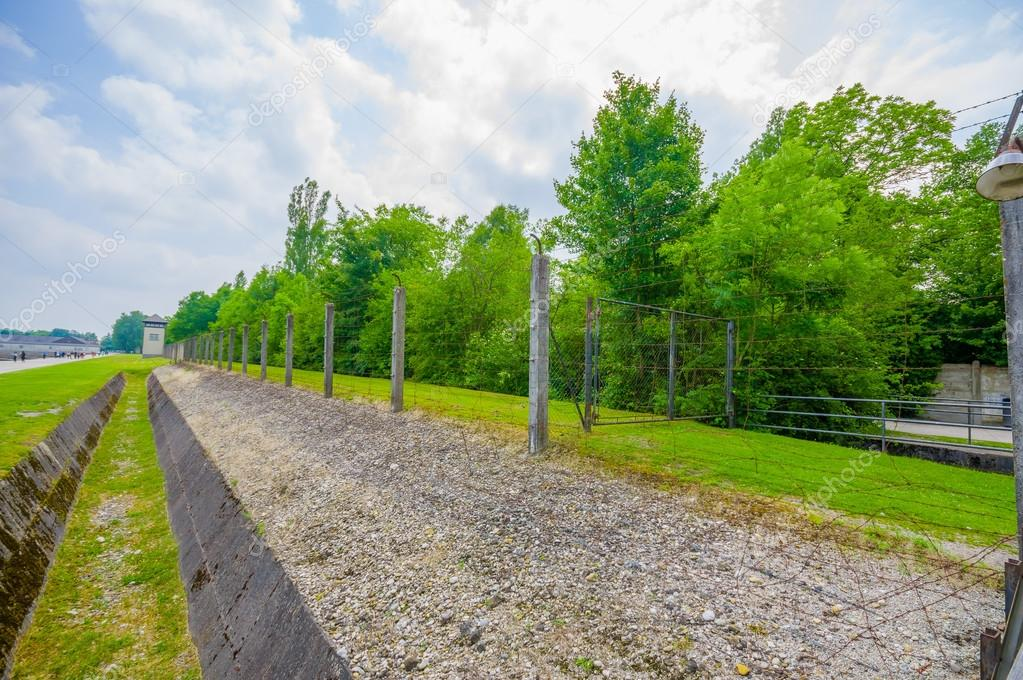 Dachau, Germany - July 30, 2015: Ditch and barbed wire fence ...