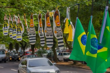 PORTO ALEGRE, BRAZIL - MAY 06, 2016:brazilian flags hanging next to dilma rousseff and sergio moro cartoons in the street