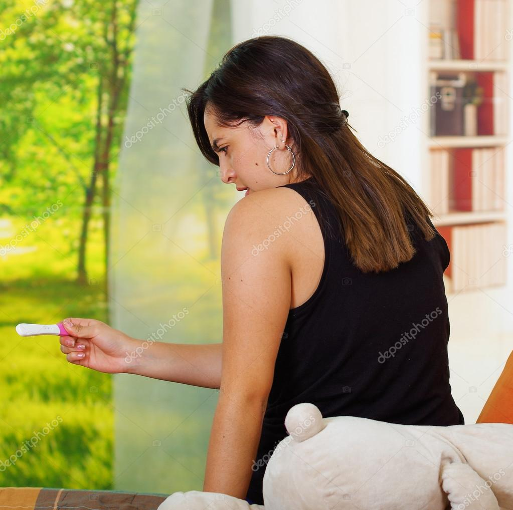 Young Woman Holding Out Hands In Disbelief Stock Image