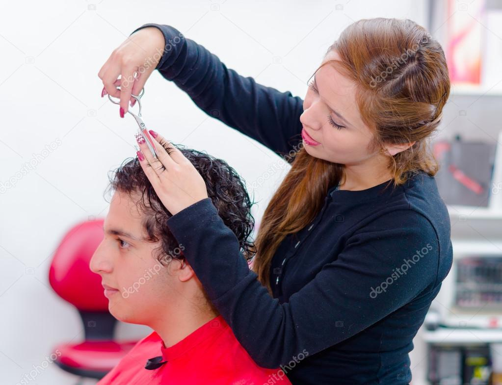 professional hairstylist is cutting a curly man hair with scissors stock photo 122701990 - Professional Hairstylist