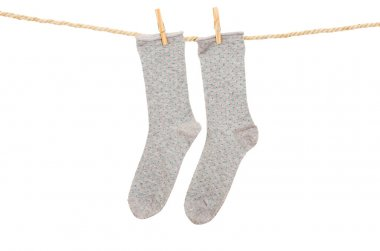 socks hanging on a rope clothesline
