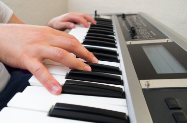 closeup photo of a persons hands playing piano
