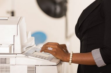 Office womans hand working copy machine