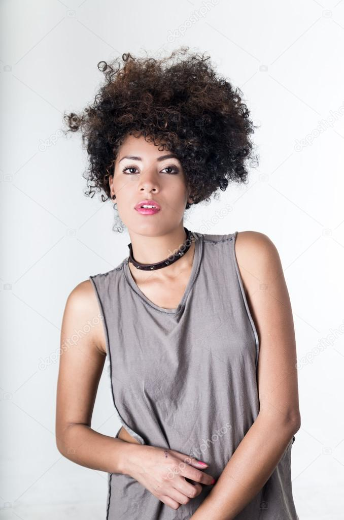 Hispanic Brunette Model With Afro Like Hair Wearing Casual Grey
