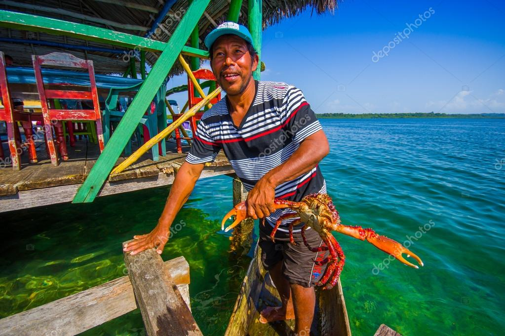 BOCAS DEL TORO, PANAMA - APRIL 24, 2015 : local fisherman returning with the morning catch