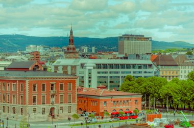 OSLO, NORWAY - 8 JULY, 2015: Great view from roof of opera building showing city rooftops and green hillsides in distance