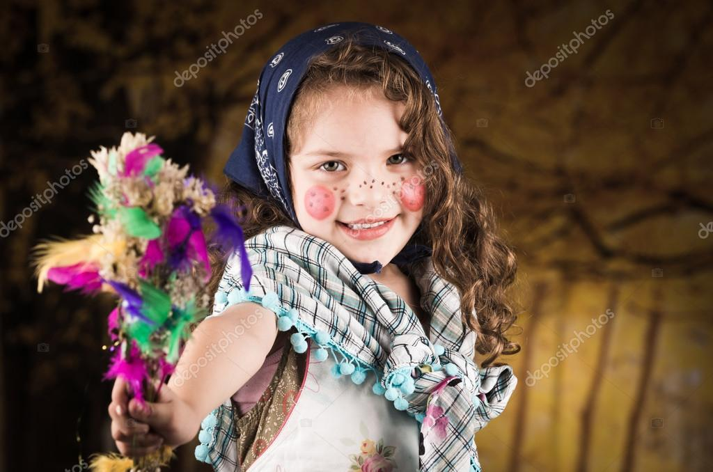 Adorable little girl dressed as a traditional easter witch