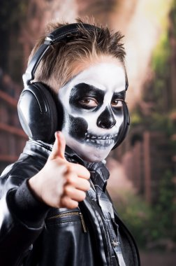 Young tough boy with skull make up