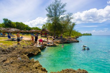 BAY OF PIGS, CUBA - SEPTEMBER 9, 2015:  Tourist attraction for swimming in Cueva de los Peces,  seaside cave