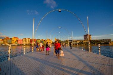 WILLEMSTAD, CURACAO - NOVEMBER 1, 2015:  Queen Emma Bridge is a pontoon bridge across St. Anna Bay