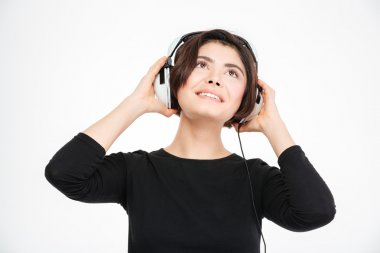 Happy woman listening music in headphones
