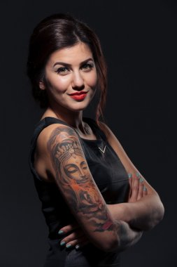 Attractive smiling young woman with tattoo on her hands