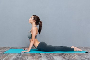 Young beautiful fitness girl doing yoga exercise
