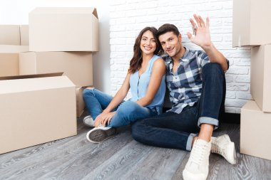Young couple with boxes and flat keys