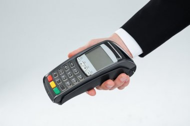 Hand of businessman holding payment terminal