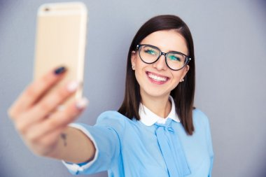 Smiling businesswoman making selfie photo