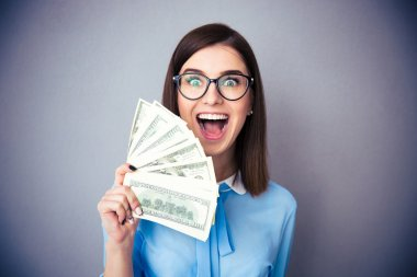 Businesswoman holding bill of dollars and shouting