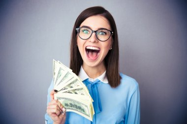 Businesswoman holding bill of dollars and screaming