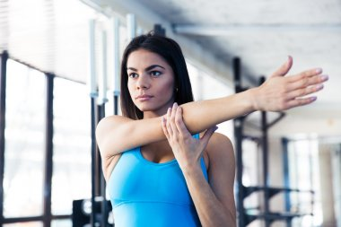 Beautiful woman stretching hands