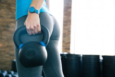 Woman working out with kettle ball