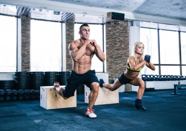 Woman and man working out at gym