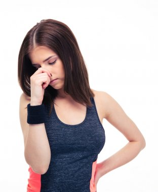 Fitness woman covering her nose with hand