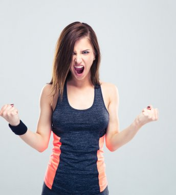 Angry young fitness woman screaming