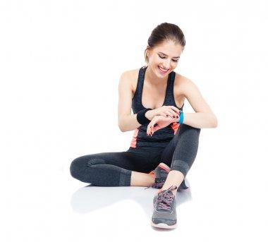 Sporty woman using smart watch