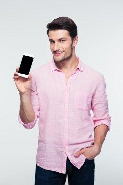 Businessman showing blank screen smartphone
